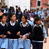 Lots of school kids.  The different uniforms designate different schools.  All students wear uniforms.