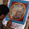 This is called Thanka painting.  They meditate as they paint.  One painting can take months.