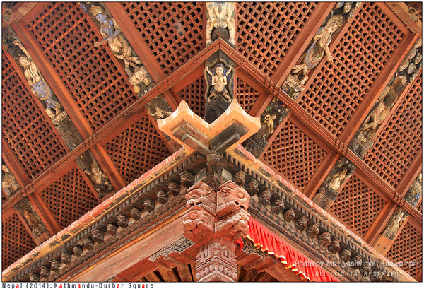 Detailed wood carvings at the ceiling