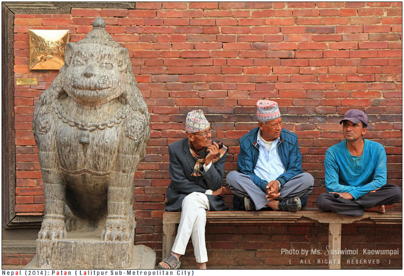 Nepalese men hung out in front of the old Royal Palace