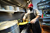 Devi Lal Niraula, a cook at Yummy MO: MO Brattleboro, on Canal Street, in Brattleboro, Vt., cooks a meal for an order to go on Wednesday, April 7, 2021. Yummy MO: MO Brattleboro is a new Nepalese restaurant that opened up in February.