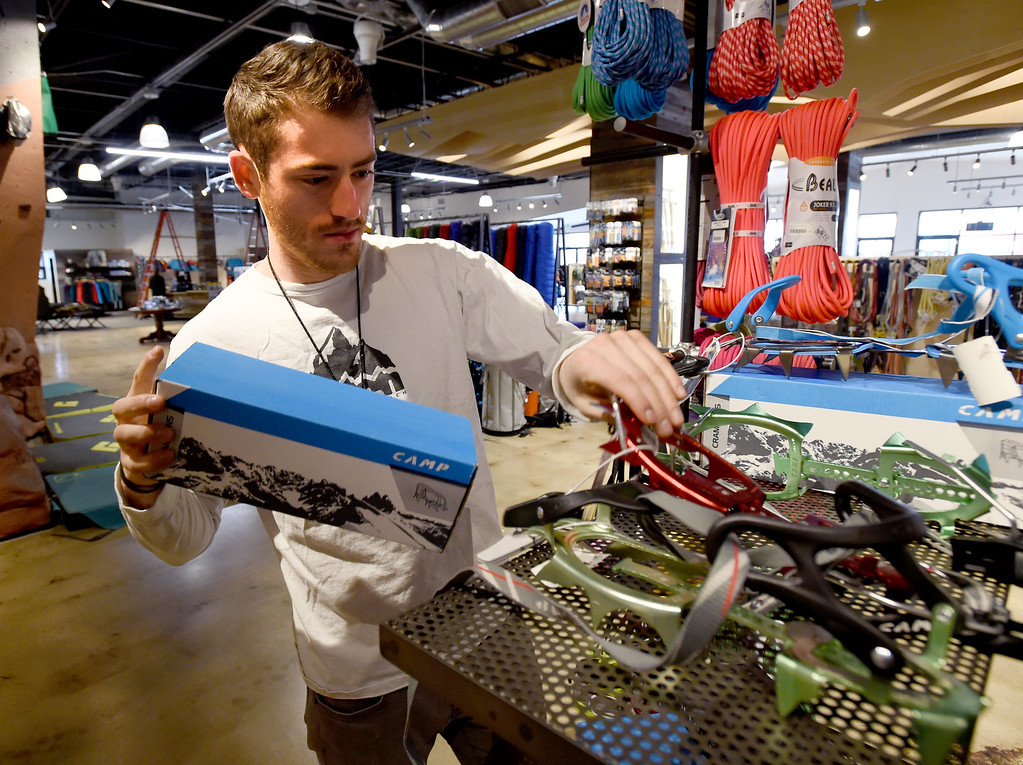 . Jon Klothe works on a display in the climbing area. Neptune Mountaineering in Boulder is getting a complete makeover. For more photos, go to dailycamera.com.com. Cliff Grassmick  Photographer January 30, 2018