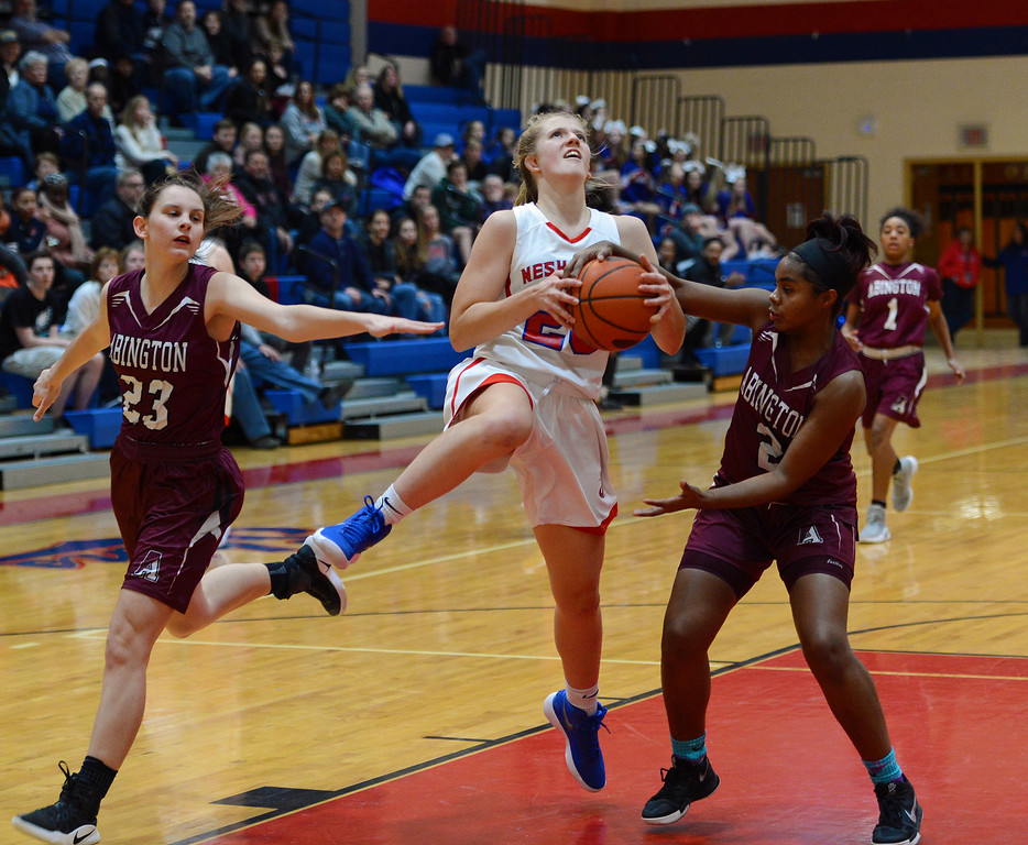 . Neshaminy sophomore Kelli Kowalick (25) is fouled on way to basket in Lady Skins win over Abington Jan. 3 on Neshaminy\'s home court. (John Gleeson � 21st-Century Media)