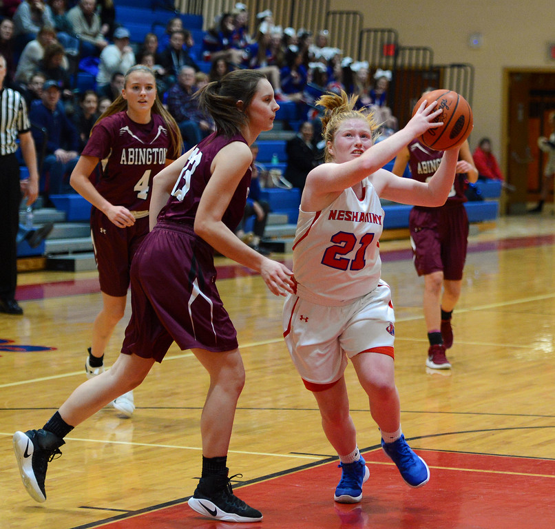 . Kristin Curley (21) drives by Miranda Liebtag (23).