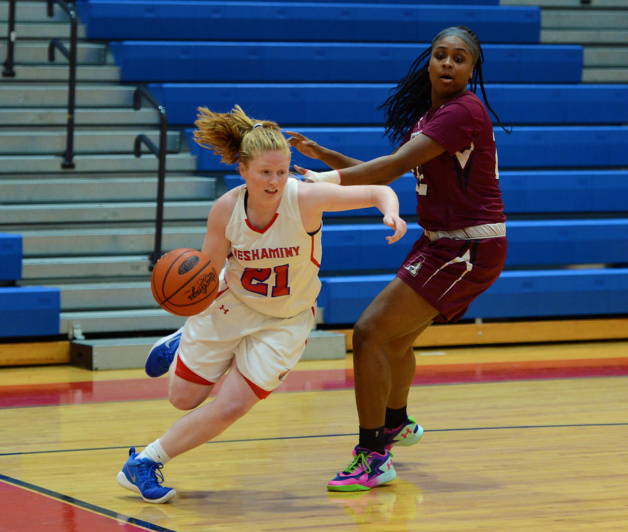 . Kristen Curley (21) drives around Kassandra Brown (22).