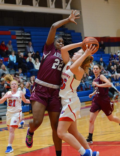 Kassondra Brown (22) rejects Kelli Kowalick's (25) shot.