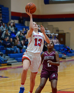 Olivia Scotti (13) drives to the basket.