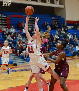 Kristin Curley (21) drives in for a layup.
