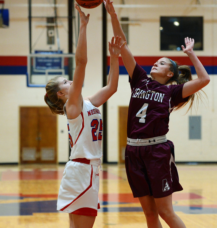 . Kelli Kowalick (25) tries to shoot over Camryn Lexow (4).
