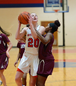 Brooke Mullin (20) is fouled by Britney James (2).
