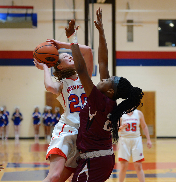 . Brooke Mullin (20) shoots over Kassondra Brown (22).