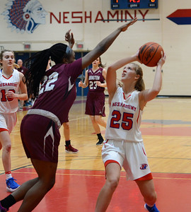 Kassondra Brown (22) towers over Kelli Kowalick (25).
