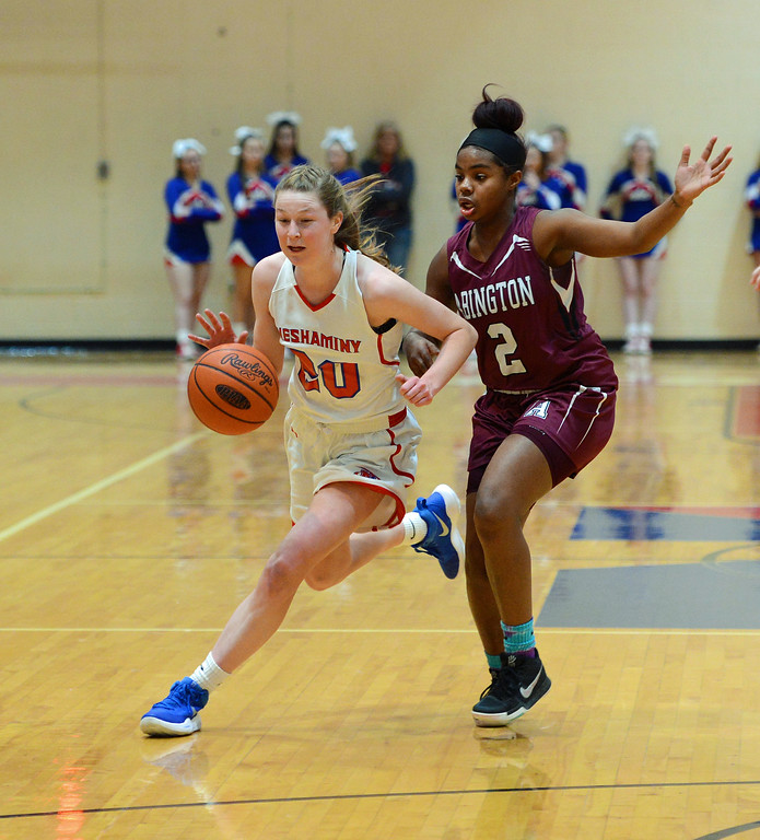 . Brooke Mullin (20) drives by Britney James (2).