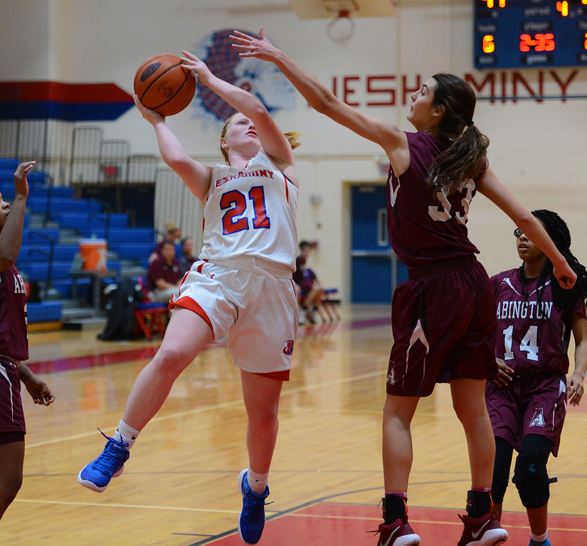 . Kristin Curley (21) tries to shoot over Sam Brusha (33).