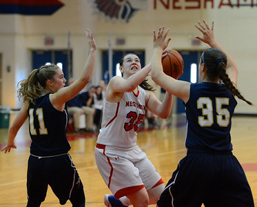 Neshaminy sophomore Alison Harvey drives between CR South senior Payton Spadaccino (11) and Hannah Binder (35) in Lady Skins win over the Golden Hawks Feb. 18 at Neshaminy HS. (John Gleeson – 21st-Century Media)