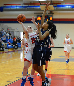 Neshaminy sophomore Meghan Ansel (22) is guarded by Faith Turner (25).