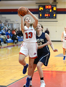 Emily Alexis (13) drives hard to the basket.
