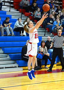 Freshman Olivia Scotti (15) nails a three-pointer.