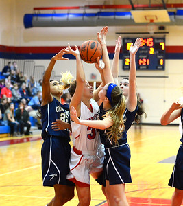 Devon Storms (34) is surrounded by Faith Turner (25), Kasey Schlupp (23), and Allison Mcgowan (32).
