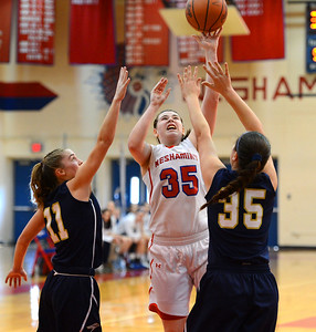 Allison Harvey (35) shoots over Payton Spadaccino (11) and Hannah Binder (35).