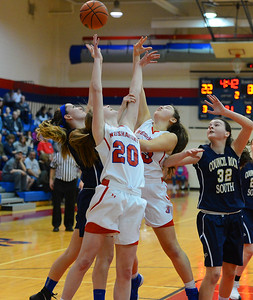 Brooke Mullin (20) battles for rebound.