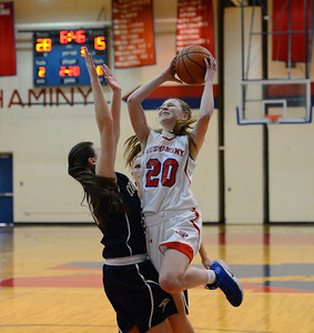 Brooke Mullin (20) drives into Allison McGowan (32).