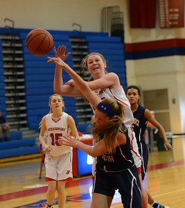 Brooke Mullin (20) is fouled on a driving layup.