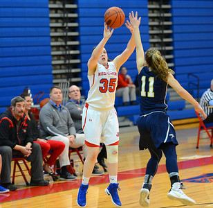 Neshaminy sophomore Alison Harvey (35) nails a three pointer in Lady Skins' win over the Golden Hawks Feb. 18 at Neshaminy HS. (John Gleeson – 21st-Century Media)