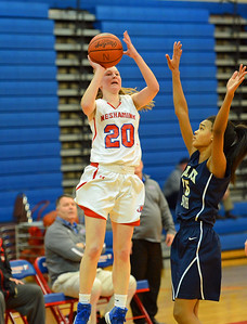 Brooke Mullin (20) fires up a last second three-pointer.