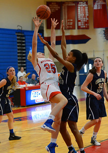 Neshaminy freshman Kelli Kowalick (25) is fouled by Faith Turner (25).