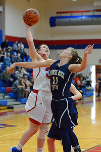 Allison Harvey (35) shoots over Peyton Spadaccino (11).