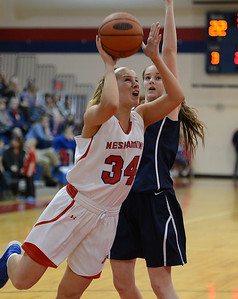 Devon Storms (34) drives by Bailey Vetter (22).