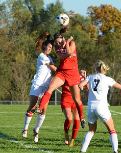 Nicole Palmer (11) vies with Carly Hickey (21) for a header.