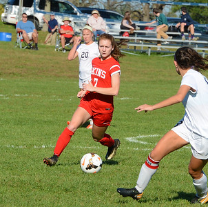 Gina Sexton (7) tracks down a free ball.