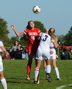 Deana Lebotesis (16) battles Julie Rebh (3) for header.