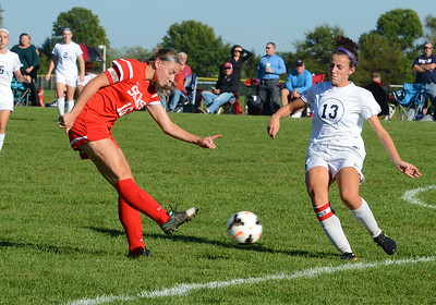 Deana Lebotesis (16) boots ball by Callie Deola (13).