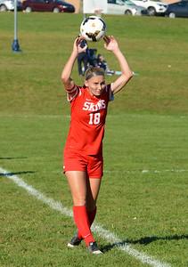 Jackie Ziegler (18) sends the ball inbounds.