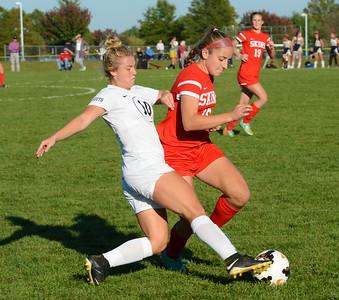 Paige Mikula (10) advances the ball upfield.