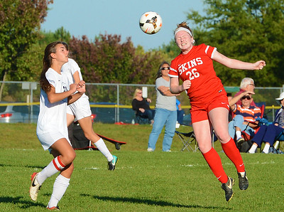 Kristin Curley (26) and Carly Hickey (21) go after header.
