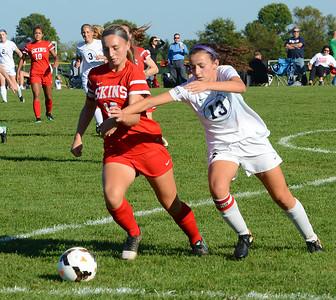 Deana Lebotesis (16) battles Callie Deola (13) for the ball.