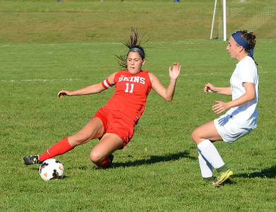 Neshaminy's Nicole Palmer (11) goes all out for the save.