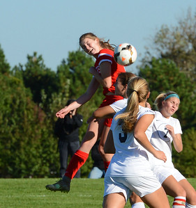 Brooke Mullin (17) goes high for a header.