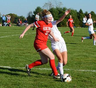 Kristin Curley (26) moves by a CR South defender.