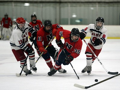 Anthony Sabatin (35) and Antonio Alicea (41) race Owen Long (13) and Alex Wassrman (8) to the puck.