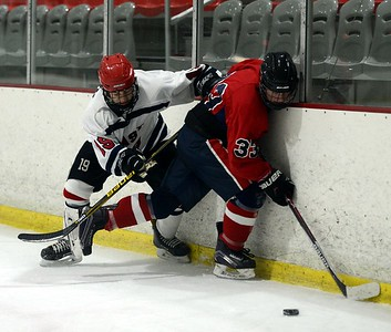 Aric Miller (33) and Colin Quinn (19) fight for possession on boards.