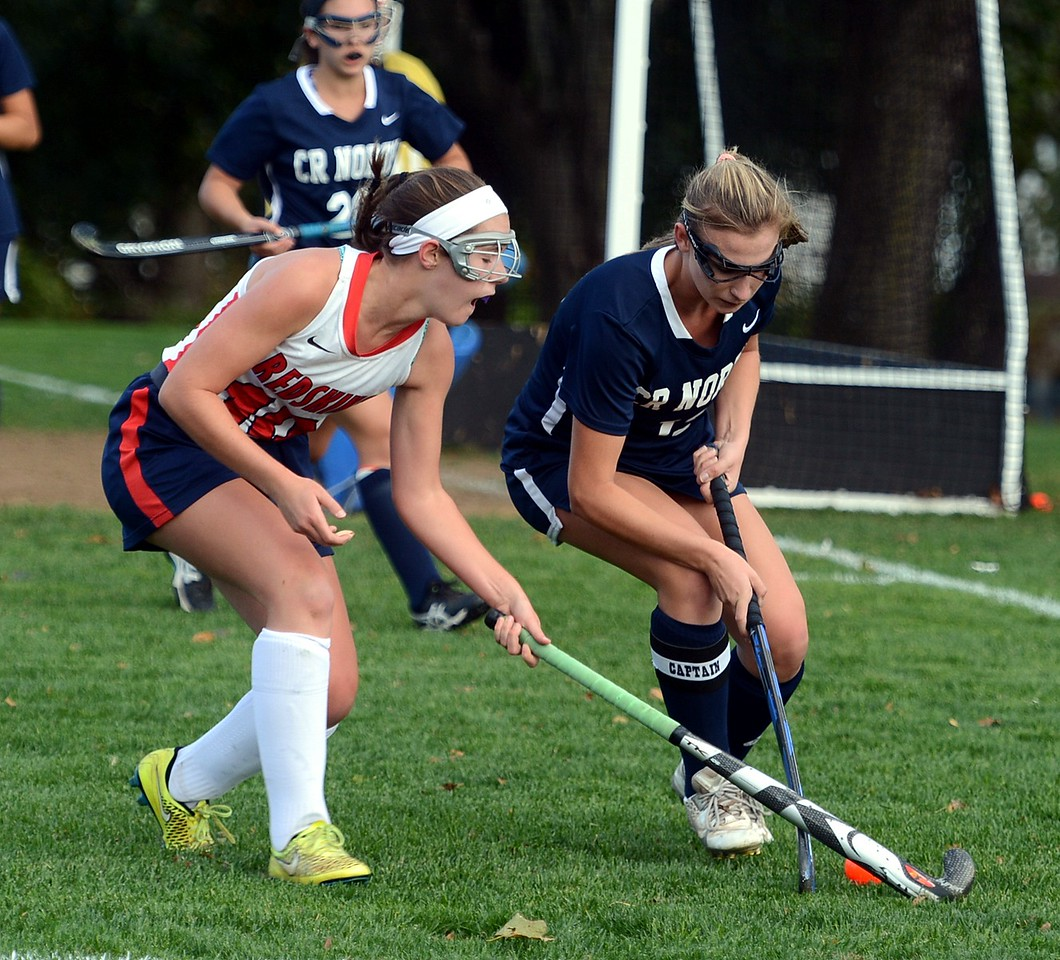 Kayla Connelly (10) challenges Claire Jarema (13) for possession.