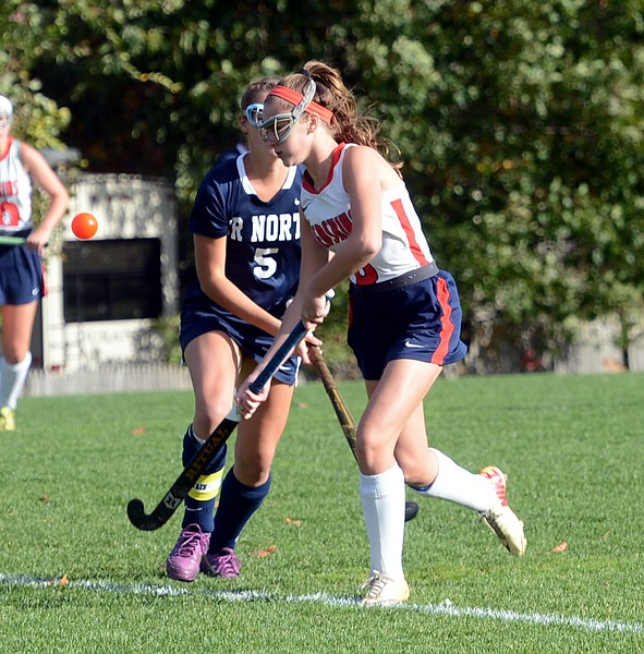Abby Geisler, right, keeps her eye on the ball in District 1-AAA playoff opener against Council Rock North Oct. 24 at Neshaminy. The Skins won 2-1 but lost 3-2 to Methacton in the Round of 16. (John Gleeson – 21st-Century Media)