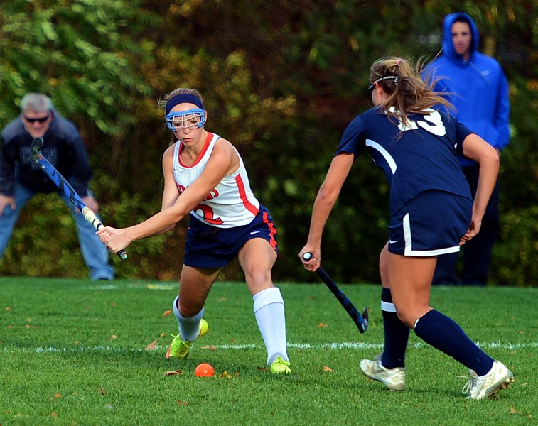 Taylor Benton (2) advances the ball for Neshaminy field hockey in District 1-AAA playoff opener vs. Council Rock North Oct. 24 on the Skins home field. (John Gleeson – 21st-Century Media)