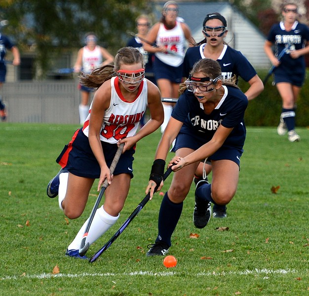 Payton Ritchie (30) and Sarah Everett (34) charge the ball.