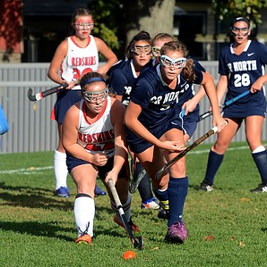 Elayno Curtin (22) and Julianne Mangano (5) race for ball.